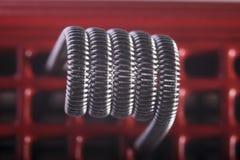 Ejemplo vaping torcido de las bobinas del filamento multi Fotos de archivo