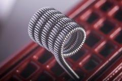 Ejemplo vaping torcido de las bobinas del filamento multi Imagen de archivo libre de regalías