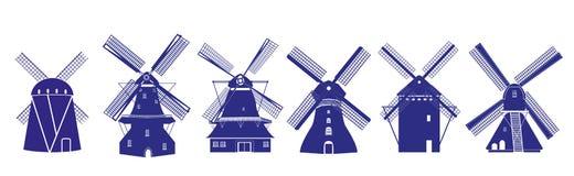 Ejemplos holandeses de los molinoes de viento en colores del azul de la cerámica de Delft Foto de archivo libre de regalías