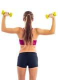Ejercicio de la pesa de gimnasia para los brazos Foto de archivo libre de regalías