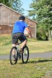 Ejercicio del ejercicio de Retiree Male Cyclist del atleta imagenes de archivo