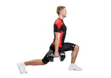 Ejercicio muscular del hombre en un fondo blanco Fotografía de archivo libre de regalías