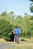 Ejercicio triste de Retiree Male Cyclist del atleta imagenes de archivo