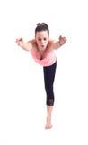Ejercicios practicantes de la yoga:  Actitud del guerrero - Virabhadrasana Imagenes de archivo