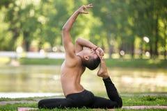 man yoga eka pada rajakapotasana king pigeon pose stock