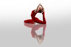 Ekapadaradzhakapotasana yoga Stock Photo