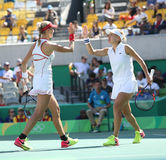Ekaterina Makarova (L) and Elena Vesnina of Russia in action during women's doubles final of the Rio 2016 Royalty Free Stock Image