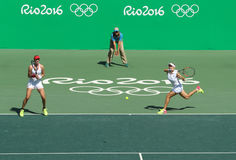 Ekaterina Makarova (L) and Elena Vesnina of Russia in action during women's doubles final of the Rio 2016 Stock Images