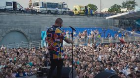 Ekaterinburg, Russia - August, 2019: View from the stage with singing on people fans. Action. Performance on stage on a stock footage