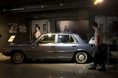 Ekaterinburg, Russia - September 24.2016: Wax figure and car in museum. Ekaterinburg, Russia - September 24.2016: People at excursion in Vladimir Vysotsky`s Royalty Free Stock Image