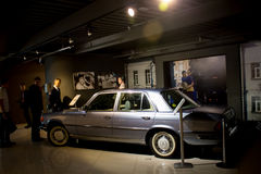 Ekaterinburg, Russia - September 24.2016: Wax figure and car in museum. Ekaterinburg, Russia - September 24.2016: People at excursion in Vladimir Vysotsky`s Royalty Free Stock Photo