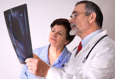 EKG. Doctor and patient looking at an EKG Stock Photo