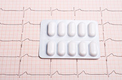 EKG chart with pills Stock Photography