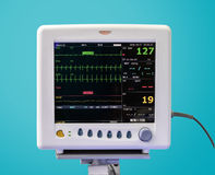 EKG Monitor in ICU Unit. On Blue Background royalty free stock images
