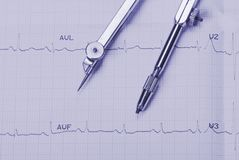 EKG printout and compasses Stock Image