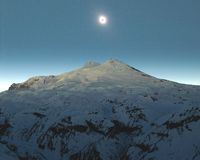 Eklipse über Elbrus Stockfotos