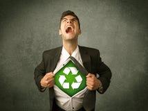 Ekologa biznesowy mężczyzna drzeje z koszula z przetwarza znaka zdjęcie stock