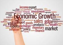 Ekonomisk tillväxtordmoln och hand med markörbegrepp fotografering för bildbyråer
