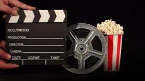 Ekranowa rolka z popkornem i clapboard zbiory wideo