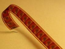 Ekranowy celuloid nad żółtym tłem fotografia stock