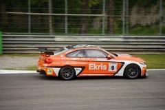 Ekris BMW M4 GT4 samochodowy ścigać się przy Monza Zdjęcia Stock