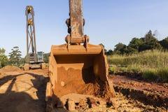 Ekskawatoru kosza budowy Dźwigowe maszyny obrazy royalty free