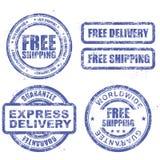 Ekspresowa dostawa i uwalnia na całym świecie wysyłać - błękitni znaczki Obraz Stock