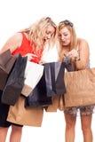 Ekstatische Mädchen mit Einkaufstaschen Stockbilder