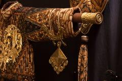 Ekstrawagancki kostiumowy wschodni Asia, wioska, nieociosany wystrój, tradycyjny odziewa Obraz Royalty Free