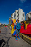 Ekuadorianischer Flaggenverkäufer mit mannigfaltiger Auswahl Stockbild