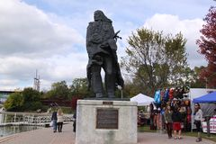 Ekwabat Watching Over Bronze Statue at Potowatami Park Stock Images