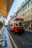 An elétrico. Eletric or elétrico in lisbon with passenger red Stock Photo