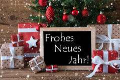 El árbol de navidad colorido con los copos de nieve, Neues Jahr significa Año Nuevo Foto de archivo libre de regalías