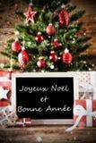 El árbol de navidad con Bonne Annee significa Feliz Año Nuevo Fotos de archivo