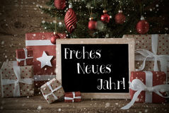 El árbol de navidad nostálgico, copos de nieve, Neues Jahr significa Año Nuevo foto de archivo