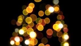 El árbol del Año Nuevo de Bokeh enciende el centelleo inconsútil en fondo negro animación Lazo-capaz 3d Feliz Navidad y nuevo fel almacen de video