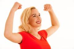 El éxito rubio joven del gesto de la mujer de Attrctive con los brazos sube el isolat Fotos de archivo