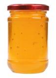 El único tarro de cristal cerrado con la miel Imagenes de archivo