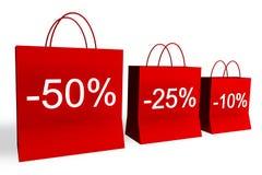 el 10, 25, y 50 por ciento de bolsos de compras Foto de archivo libre de regalías