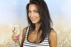 El Año Nuevo - champán de consumición de la mujer joven Fotografía de archivo