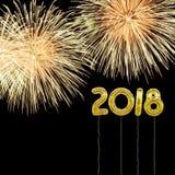 El Año Nuevo 2018 con estilo de la hoja de oro hincha y los fuegos artificiales Foto de archivo libre de regalías