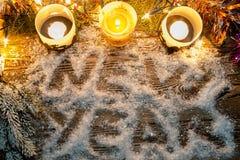 El Año Nuevo de la inscripción en la nieve Fotos de archivo