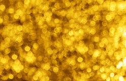 El Año Nuevo de la Navidad enciende el fondo de oro del bokeh Fotografía de archivo libre de regalías