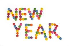 El AÑO NUEVO del título escrito de los sabelotodos coloreados Foto de archivo