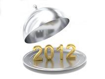 El Año Nuevo 2012 en una placa de plata Imagen de archivo libre de regalías