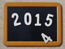 El Año Nuevo 2015 substituye el concepto 2014 en la pizarra Imagen de archivo libre de regalías