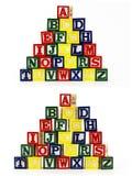 El ABC apilado del alfabeto bloquea al niño Fotografía de archivo libre de regalías