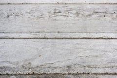 El abedul de madera texturizó a los tableros que han hecho blanco-grises del sol Foto de archivo