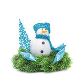El abeto de la rama de la Navidad, muñeco de nieve con la bufanda azul Fotografía de archivo libre de regalías