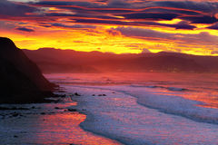 El abra from Barrika coast at red sunset Royalty Free Stock Images